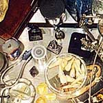 """Vanitas :Evidence, Ruin, and Regeneration"" - table from above<div id=""copy"">© Amalia Mesa-Bains</div>"