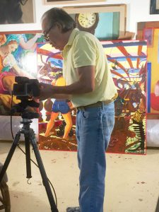 Jesse Bravo, master photographer, takes photos of Los Bucaneros
