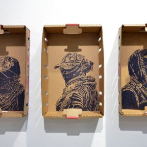 "From the ""Unnumbered Portrait"" series, lino-cut on reclaimed produce box, 16"" x 12"" x 5"" (each), 2016-18 <div id=""copy"">© Narsiso Martinez</div>"